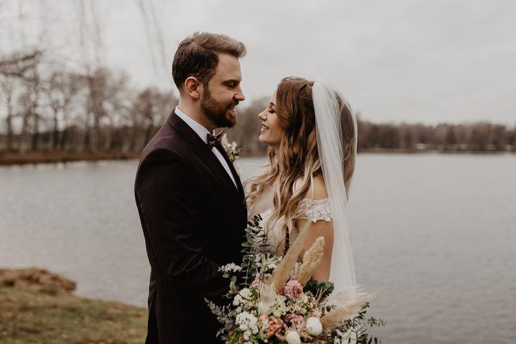 Groom in brown wedding suit for boho wedding