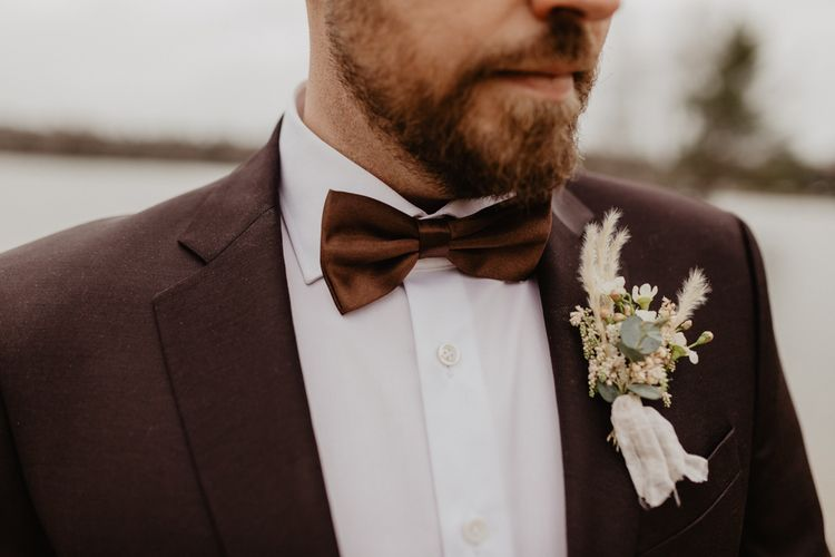 Brown wedding suit with bow tie for Germany wedding