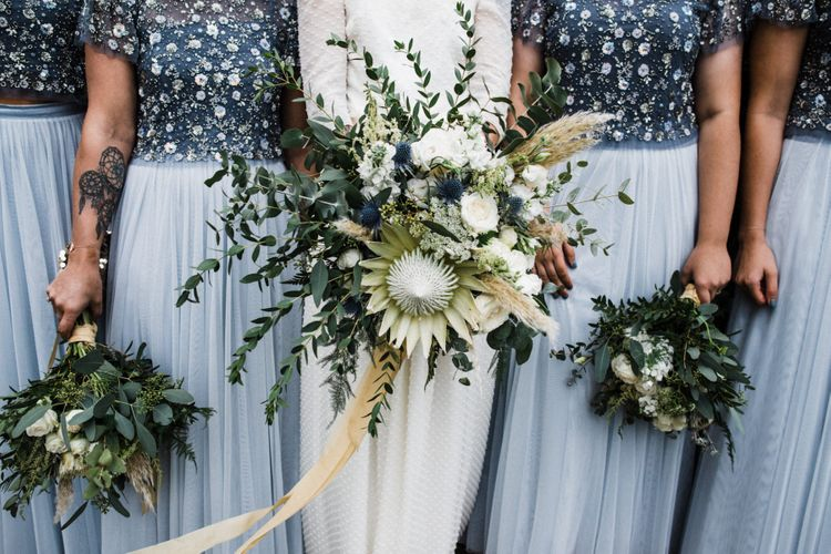 Bridesmaids and bride with creative wedding flowers