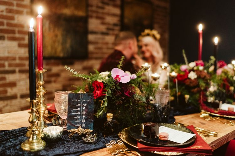 Red tablescape with bride and groom