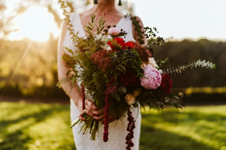 Bride with bold wedding flowers