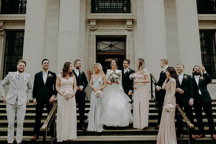 Wedding party portrait on step at registry office wedding