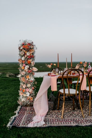 Outdoor Tablescape on Rug with Flower Column