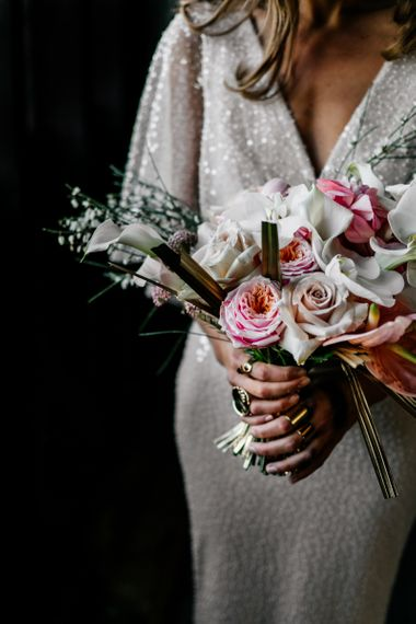contemporary bridal with gold sprayed palms, roses, orchids and anthuriums