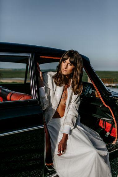 Boho Bride with Sweeping Fringe Sitting in a Wedding Car