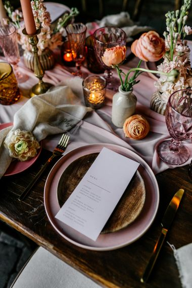 Place Setting with Blush Pink Crockery and Ink Wells Filled with Ranunculus Flower Stems