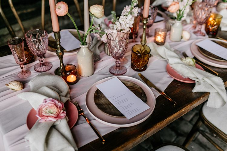 Elegant Place Setting with Pink Charger Plate and Glass Goblets