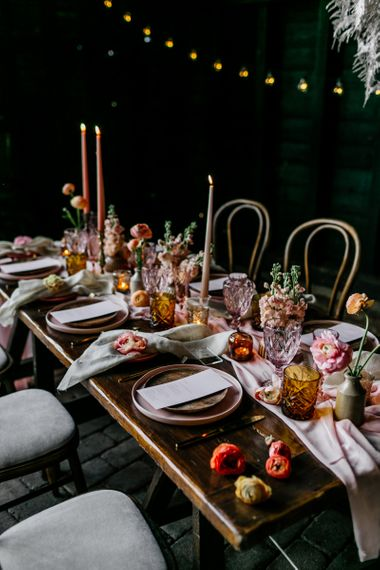 Colourful Tableware and Glass with Taper Candles, Flowers and Linens