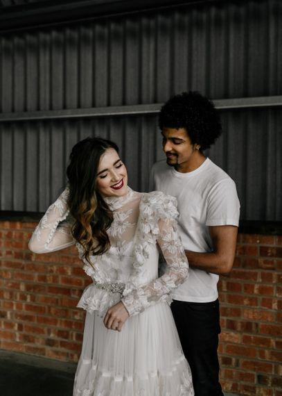 Bride Putting on a Edwardian Style High Neck Wedding Dress