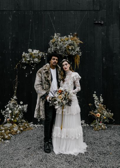 Retro Bride and Groom in High Neck Wedding Dress and Faux Fur Coat
