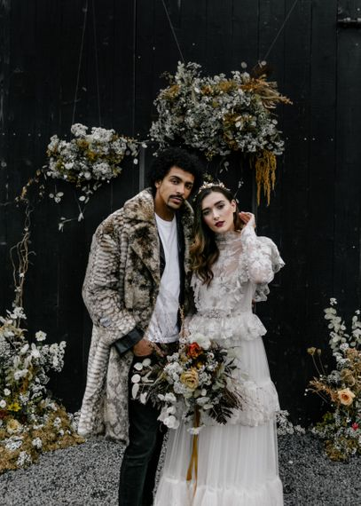 Stylish Bride and Groom in Lace Wedding Dress and Faux Fur Overcoat