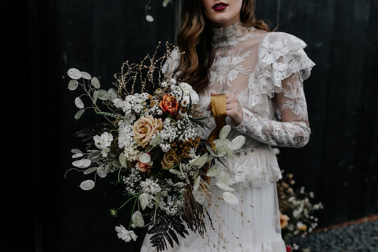 Bride in Lace High Neck Wedding Dress Holding a Dried Flower Wedding Bouquet