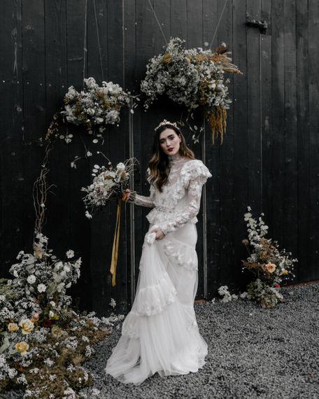 Stylish Bride in KATYA KATYA Wedding Dress with Long Sleeves and High Neck