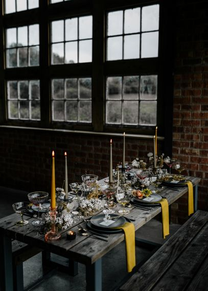 Retro Table Decor with Yellow Candles and Napkins and Dried Flowers