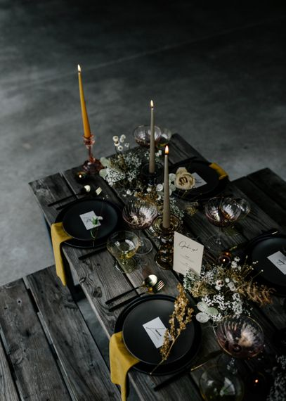 Winter Wedding Decor with Black Plates, Yellow Napkins and Taper Candles
