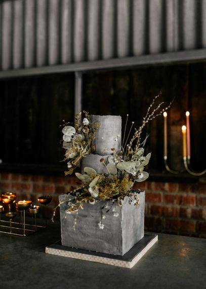 Modern Grey Concrete Wedding Cake with Moss, Eucalyptus and Twig Decor