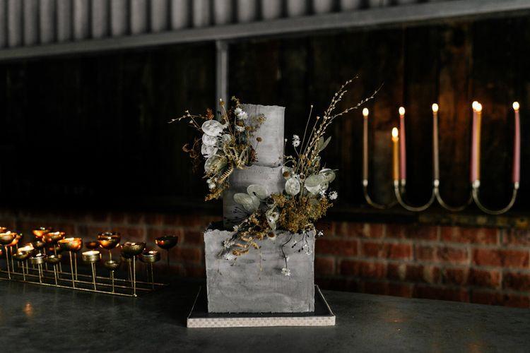 Stylish Concrete Wedding Cake with Gold Candelabras