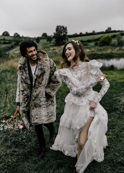 Bride in High Neck Wedding Dress and Long Sleeves and Groom in Faux Fur Overcoat
