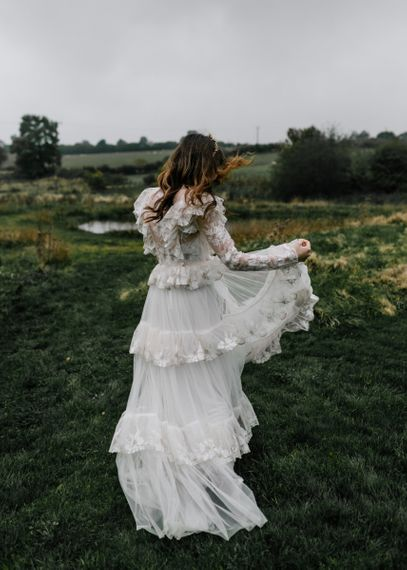 Bride in Katya Katya Lace Tiered Wedding Dress with Long Sleeves