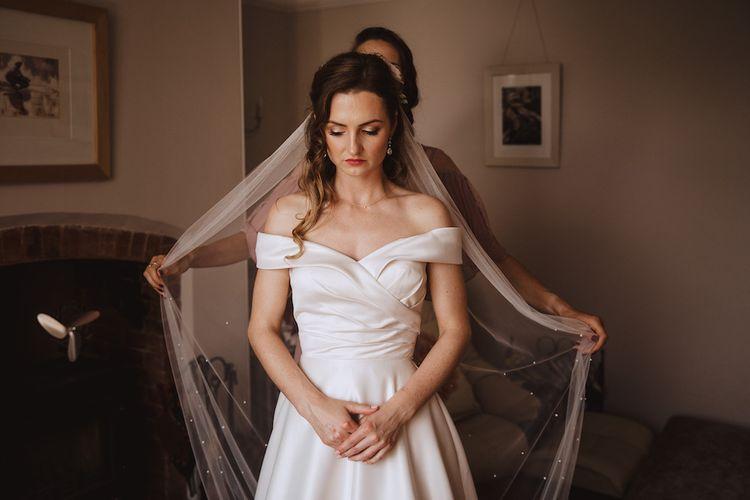 Wedding Morning Bridal Preparations with Bride in Bardot Art Couture Satin Wedding Dress