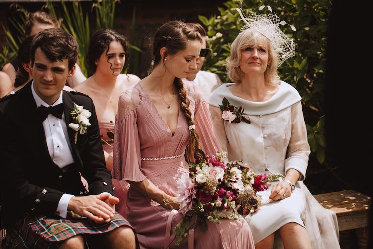 Emotional Mother of the Bride and Sister at the Wedding Ceremony