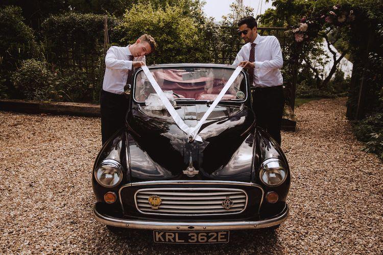 Groomsmen Tying Ribbon on a Vintage Wedding Car