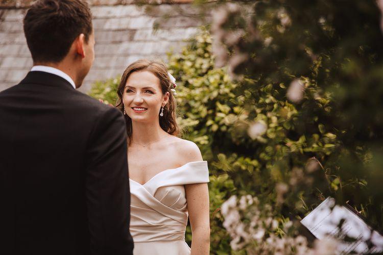 Elegant Bride in Off the Shoulder Satin Wedding Dress