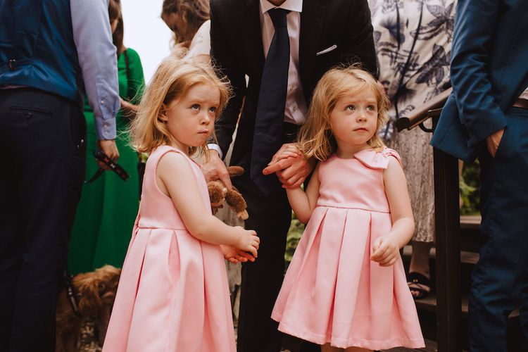 Cute Flower Girls in Pink Dresses with Bow Detail