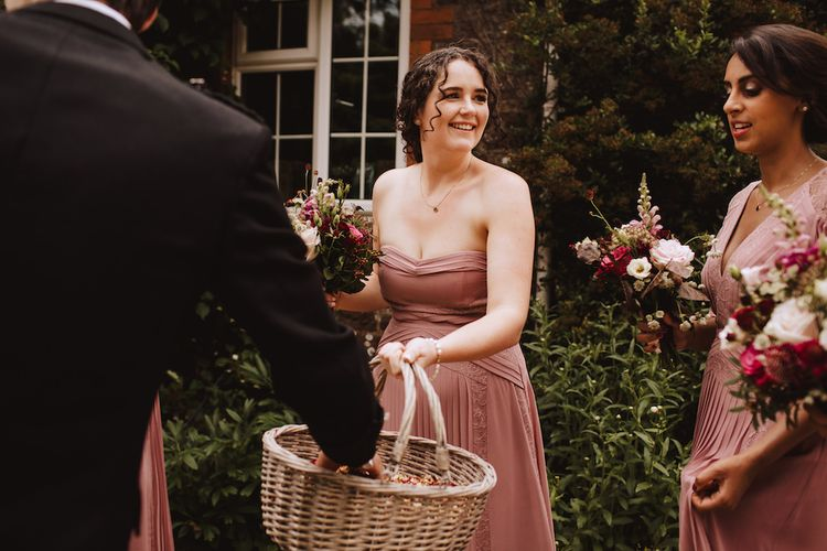 Bridesmaid in Dusky Pink Dress Holding a Confetti Basket