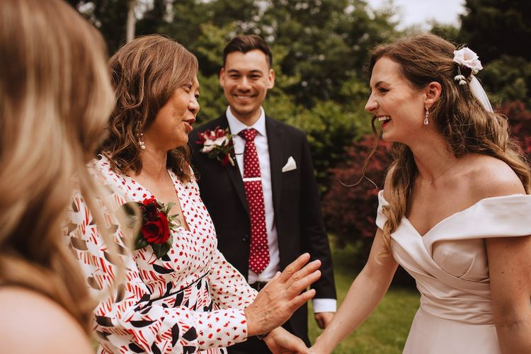 Mother of the Groom and The Bride Laughing Together