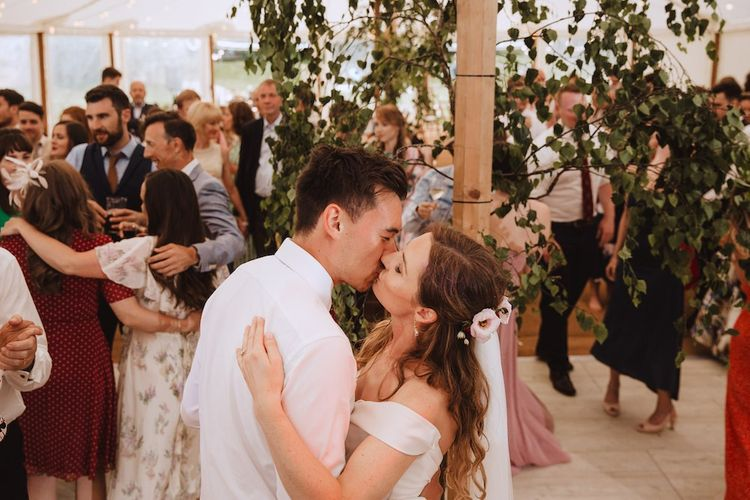 Bride and Groom Kissing on the Dancefloor