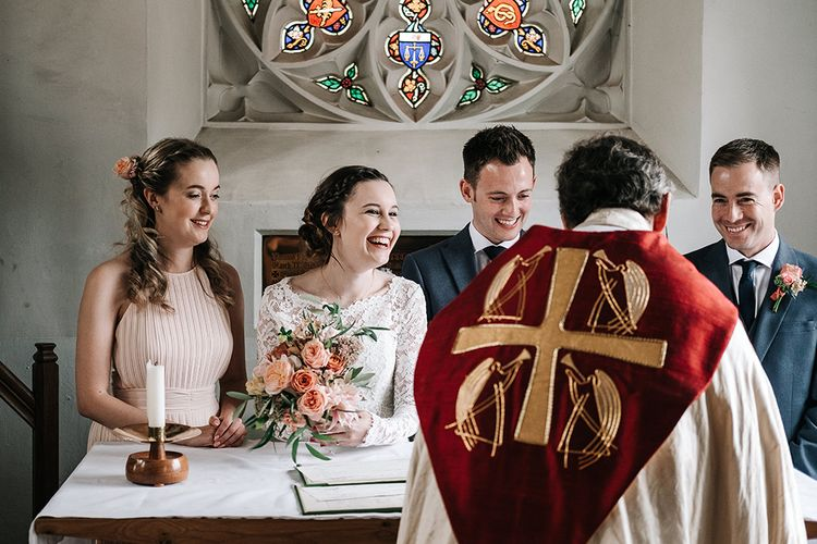 Church Wedding Ceremony | Signing the Register | Bride in Lace Gown | Groom in Next Suit | Peach Wedding at Swanton Morley House and Gardens in Norfolk |  Jason Mark Harris Photography | Together we Roam Films