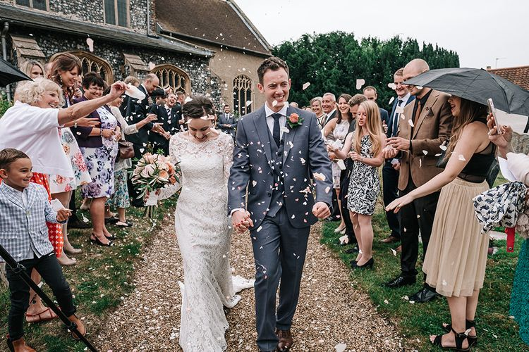 Confetti Exit | Bride in Lace Gown | Groom in Next Suit | Peach Wedding at Swanton Morley House and Gardens in Norfolk |  Jason Mark Harris Photography | Together we Roam Films