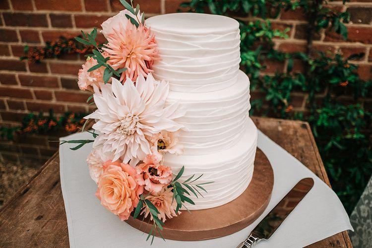 Iced Wedding Cake with Peach Dahlia Flower Decor | Peach Wedding at Swanton Morley House and Gardens in Norfolk |  Jason Mark Harris Photography | Together we Roam Films