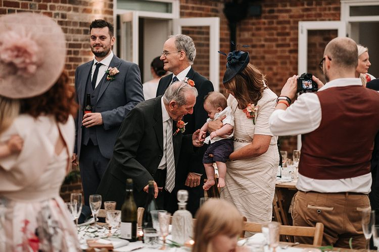 Wedding Guests | Peach Wedding at Swanton Morley House and Gardens in Norfolk |  Jason Mark Harris Photography | Together we Roam Films