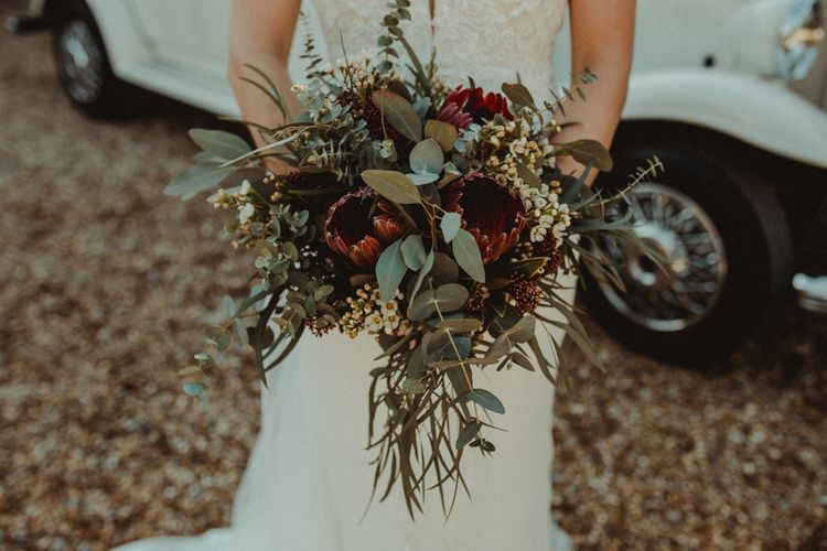 Red and Green Wedding Bouquet with Proteas and Eucalyptus