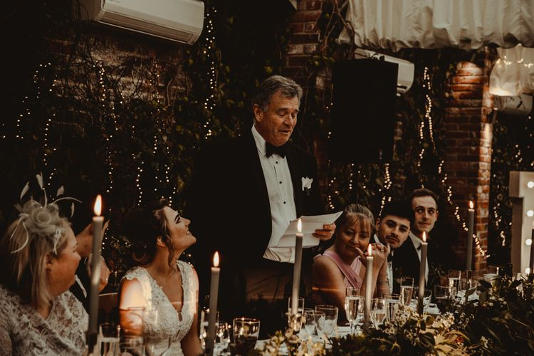 Father of the Bride Wedding Speech at the Top Table Covered in Greenery, Candles and Fairy Lights Wedding Decor