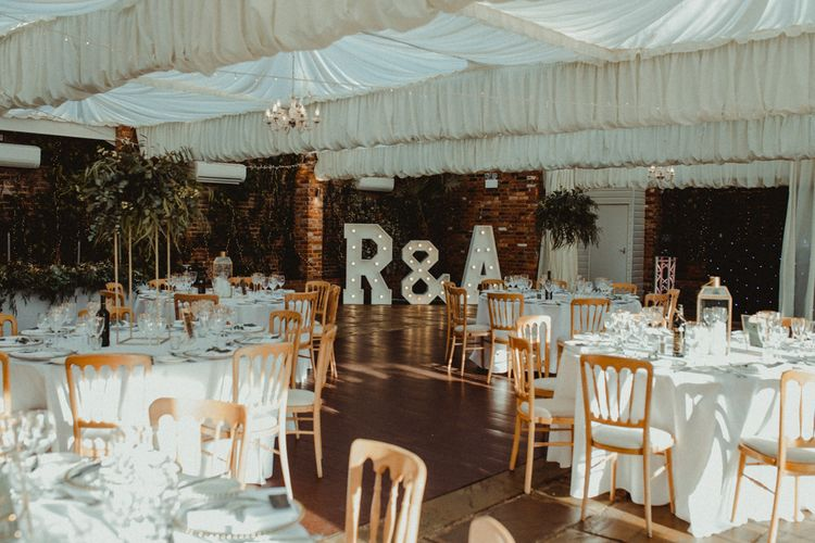 Wedding Reception Decor at Northbrook Park Wedding Venue with Giant Light Up Letters and Tall Foliage Displays