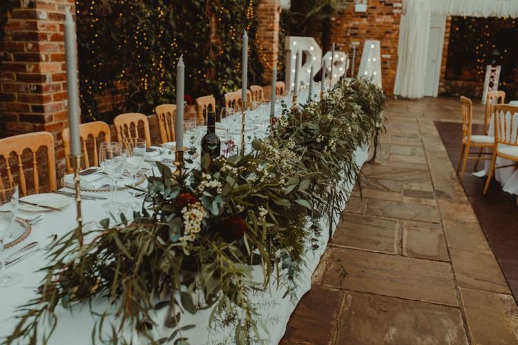 Top Table Foliage and Taper Candle Wedding Decor