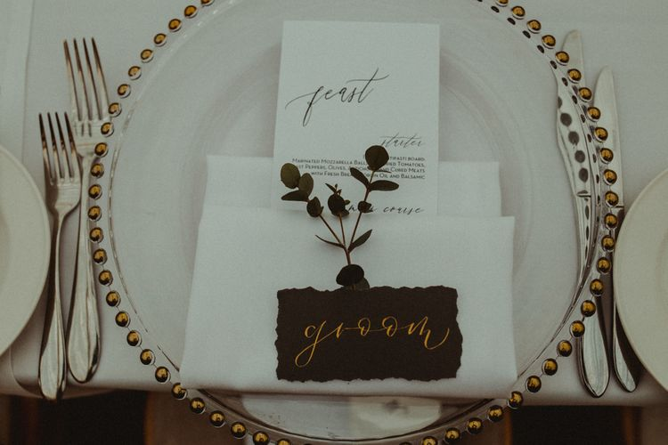 Elegant Place Setting with Glass Charger Plate, Napkin, Name Place Card and Foliage Stem