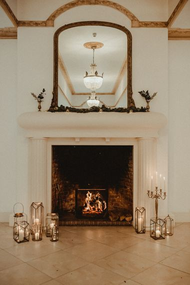 Fireplace Decorated with Candles, Lanterns and Candelabras