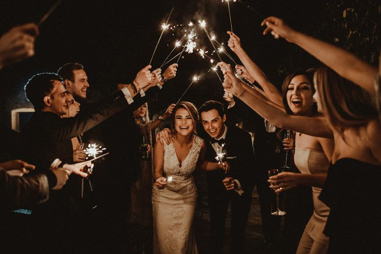 Sparkler Exit with Bride in Lace Wedding Dress and Groom in Black Tie Suit
