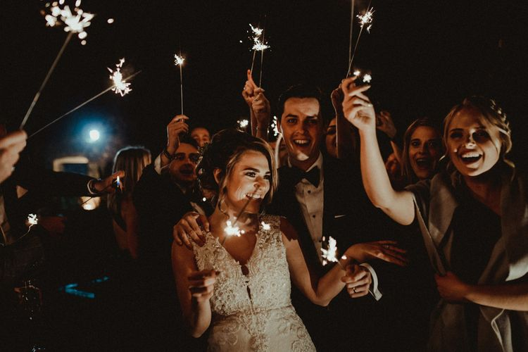 Sparkler Moment with Bride in Lace Wedding Dress and Groom in Tuxedo