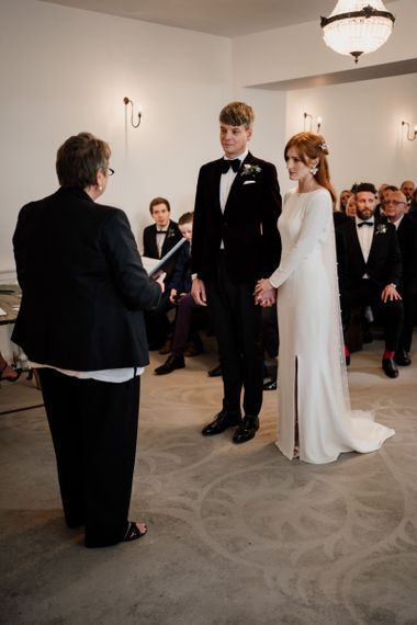 Bride and groom exchanging vows at Aswarby Recetory wedding venue