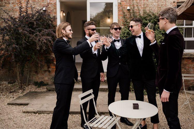 Groomsmen in black tuxedos at Aswarby Rectory wedding