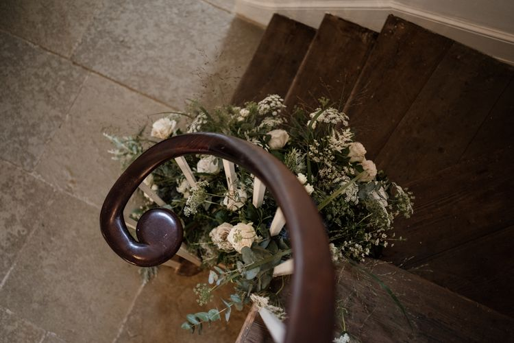 Stairs at Aswarby Rectory decorated in white and green flowers