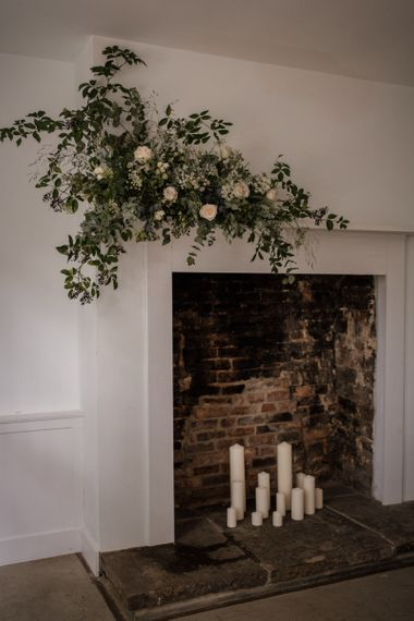 Fireplace at Aswarby Rectory decorated in white and green flowers