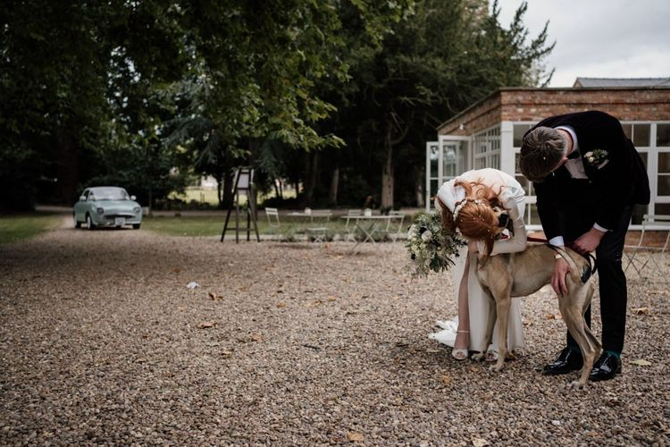 Bride and groom with their pet dog at Aswarby Rectory