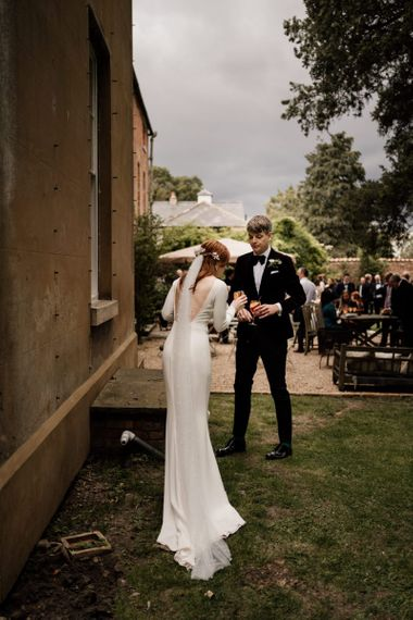 Bride in minimalist Alexandra Grecco with backless detail