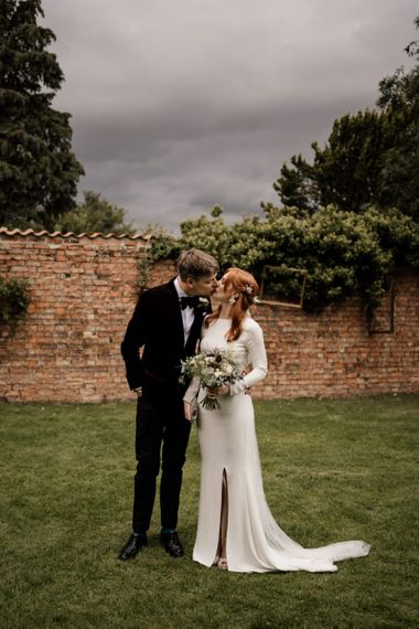 Bride and portrait with bride in Alexandra Grecco wedding dress with long sleeves